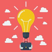 Idea lightbulb balloon with suitcase full of money