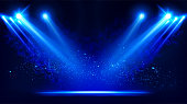 istock Illuminated stage with scenic lights and smoke. Blue vector spotlight with smoke volume light effect on black background. Stadium cloudiness projector. Mist show room. Vector. 1199262115