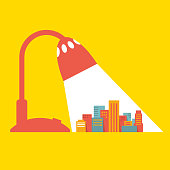 Colorful Illustration: a big city under the light of a desk lamp