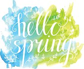 Illustration Hello spring with white words on bright watercolor background
