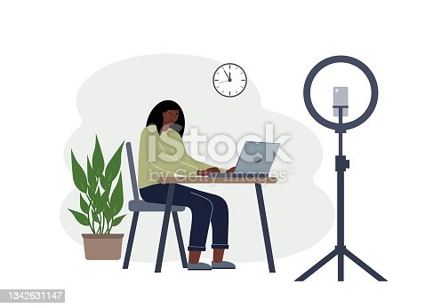 istock Illustration of a female blogger at the table with a laptop. Online filming of a training course or blog 1342631147