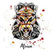 Illustration of an African mask on a watercolor background.