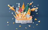 illustration of bonfire and fireworks art decorations in Christmas with suitcase concept. Creative design paper cut and craft for travel holiday winter season party. graphic idea vacation vector.