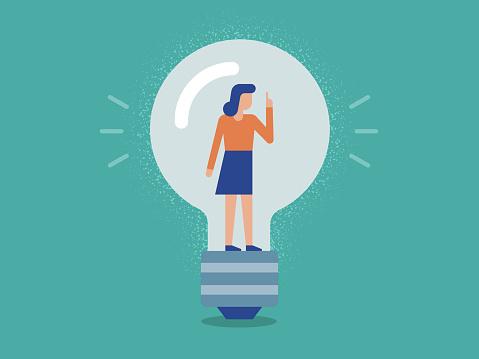 Illustration of Businesswoman inside a Lightbulb