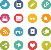 Sixteen social media icons set on a white background.  The icons are all circles of the same size in different colors that include turquoise, pink, orange, green, purple and red.  There are four circles in each row and four rows in total.  The first row features a bird, a photograph, a pencil and a chain.  The second row features a birthday cake, a calendar, quotation marks and a thumbs up.  The third row features two photos, a chat bubble, a connection symbol and a camera film.  The last row features a vector, thumbs down a heart and an icon of a large circle on top of a pole.