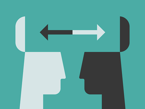 Illustration of contrasting head silhouettes exchanging ideas with open minds