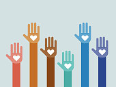 istock Illustration of group of multi-colored hands raised together 1253096102