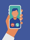 istock Illustration of hand holding smart phone with video call on screen 1216035907