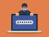 istock Illustration of laptop computer and cyber criminal looking for password 1219629042