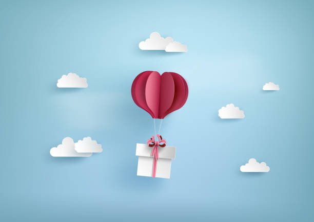 Illustration of love and valentine day Illustration of love and valentine day, balloon heart shape hang the  gift box float on the sky.paper art style. paper craft stock illustrations