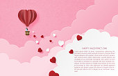 Illustration of love valentine's day banner with couple in hot air balloon and heart shape in paper cut style. Digital craft paper art.