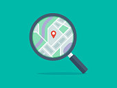 istock Illustration of magnifying glass with map on lens 1266633089