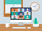 istock Illustration of tidy work-from-home office with video conference on computer screen 1219036508