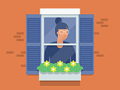 istock Illustration of young woman looking out window 1218795787