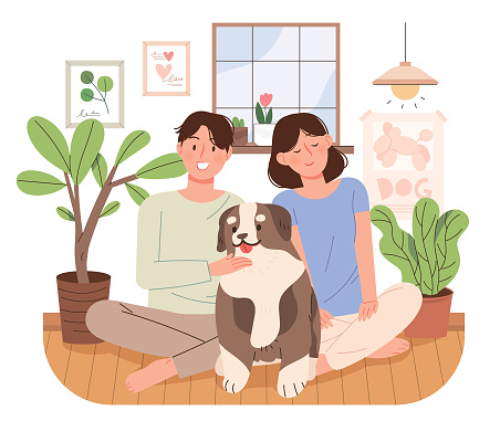In a cozy home, a young couple is sitting with their dog and having a good time.