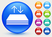 In and Out Document with Arrows Icon. This 100% royalty free vector illustration is featuring a blue round button with a drop shadow and the main icon is depicted in white. There are eight more color variations included on the right side of the image.