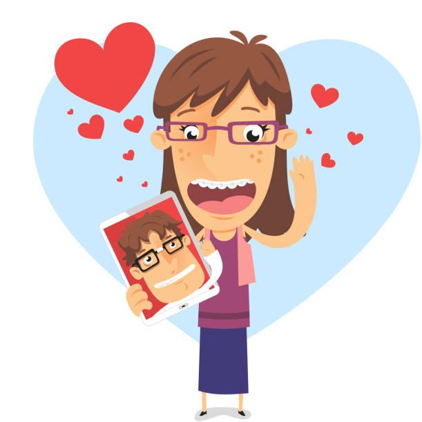 w miłości-to dziewczyna gospodarstwa ipad z nerd chłopak - ipad stock illustrations