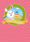 FELIZ PASCUA - HAPPY EASTER in Spanish language - symbol with rabbit holding painted eggs in his hands with green mountains and blue sky with clouds background inside a green circle on pink hearts background