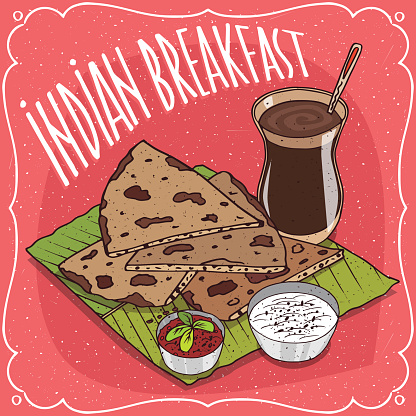 Indian breakfast with flatbread and masala chai