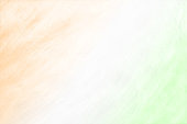 Tiranga - A horizontal vector illustration of three colors blending or merging into each other . A scratched textured wall effect. The first band is saffron or orange colored, the middle one white and the bottom most is green. Denotes the Indian National flag. Apt for Independence Day, 15 th August and Republic day 26 th January backdrops.