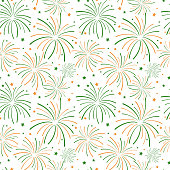 Orange and green fireworks and stars on white background