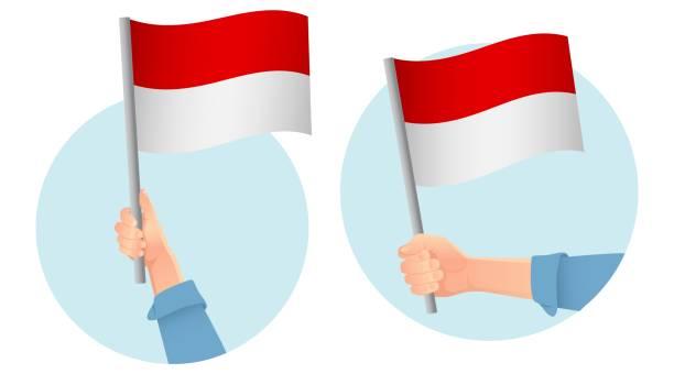 stockillustraties, clipart, cartoons en iconen met indonesië vlag in de hand - indonesische vlag