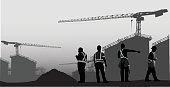A vector silhouette illustration of construction workers at a huge construction site.