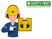 Industrial worker is presenting earmuffs sign