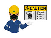 Industrial worker is presenting gas mask sign