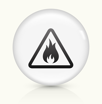 Inflammable Icon on simple white round button. This 100% royalty free vector button is circular in shape and the icon is the primary subject of the composition. There is a slight reflection visible at the bottom.