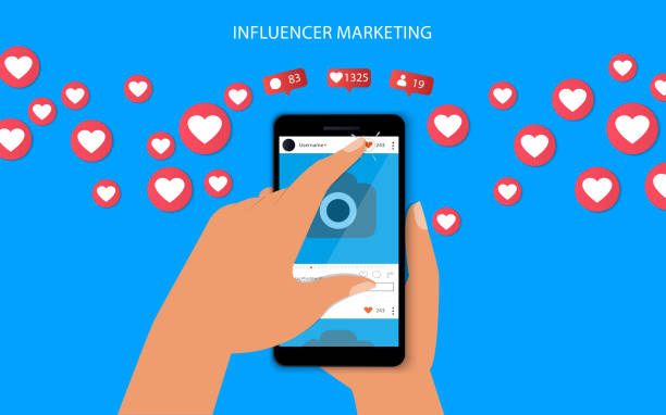 ilustrações de stock, clip art, desenhos animados e ícones de influencer marketing concept with hand holding smartphone and like and hearts illustration. - inbound marketing