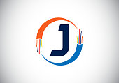 istock Initial J monogram letter alphabet with electric wire, optical fiber cable. Font emblem. 1328951229
