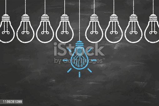 To remind the importance of innovation in the business world. Businessman holds in his hand a light bulb. New idea in human palm. To be ordinary or different. Innovation brings success. Innovation concepts on blackboard background. Innovative Idea Concepts with Light Bulb on Chalkboard Background.