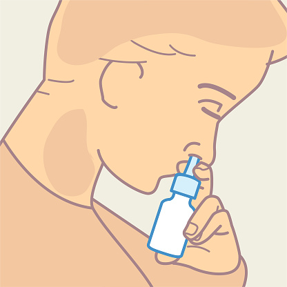 Inserting nasal spray into nostril