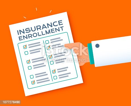 Doctor's hand giving insurance enrollment form questionnaire checklist.