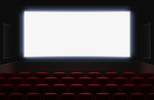 Interior Of A Cinema Movie Theatre With Shiny White Blank Screen Red Cinema Or Theater Seats