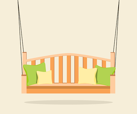 Interior. Orange swing bench with pillows.