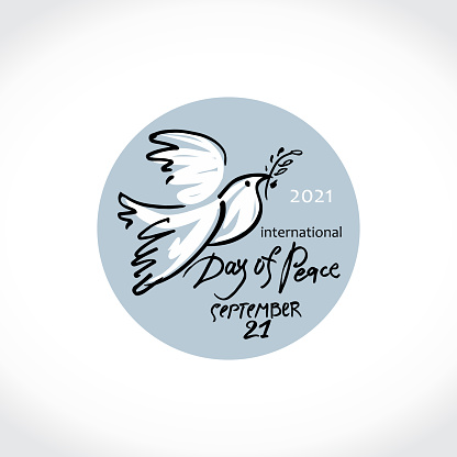 International Day of Peace. 2021. Dove with an olive branch and planet earth. Round sticker.