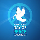 Celebrating the International Day of Peace with dove and symbol of peace on the light beam blue background