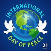 Celebrating the International Day of Peace with earth globe, doves and symbol of peace on the blue space background