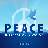 Celebrating the International Day of Peace with dove and symbol of peace on the blue mountain background