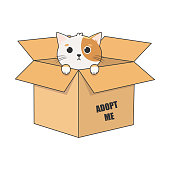 istock International Homeless Animals Day. Cute cartoon cat in a cardboard box with the words Adopt me. Vector illustration isolated on white background. 1332033515