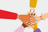 International teamwork and friendship concept with beautiful female hands of various races and nationalities putting their hands together in flat style. Isolated vector illustration