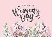 International Womens Day greeting card. Calligraphic hand written phrase and hand drawn flowers.