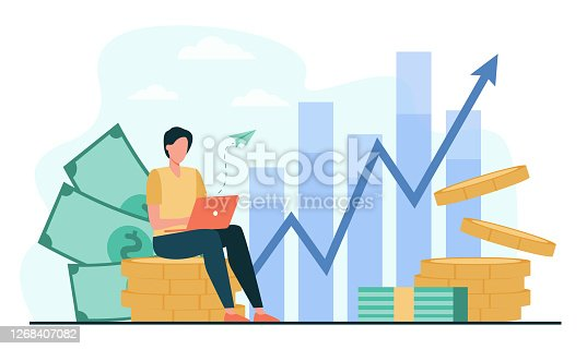 istock Investor with laptop monitoring growth of dividends 1268407082