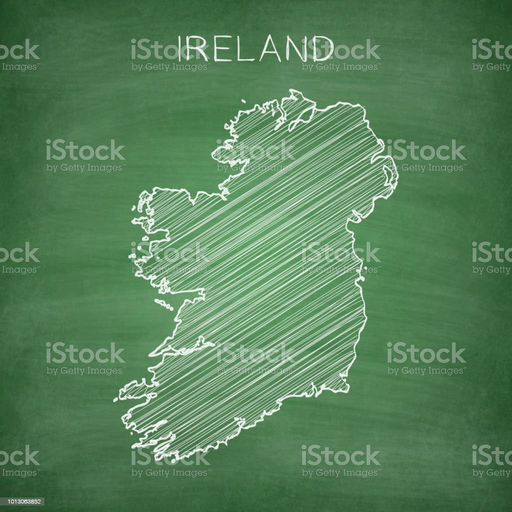 Map of Ireland drawn in chalk on a green chalkboard with chalk...