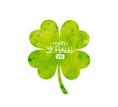 Irish holiday Saint Patrick's Day. Green watercolor quatrefoil clover.