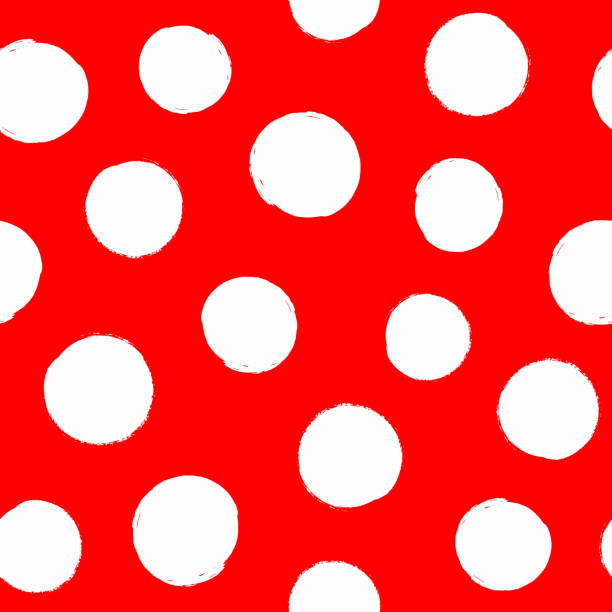 Irregular polka dot drawn by hand with rough brush. Repeated white round spots on red background. Sketch, watercolor, grunge. Irregular polka dot drawn by hand with rough brush. Repeated white round spots on red background. Sketch, watercolor, grunge. Vector illustration. polka dot stock illustrations