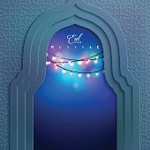 Islamic design background mosque door with geometric pattern for Ramadan Eid Mubarak card  - Translation of text : Eid Mubarak - Blessed festival