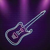 Isolated blue neon light guitar on purple brick wall.